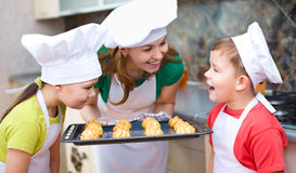 Mother with children making bread stock photography