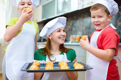 Mother with children making bread royalty free stock image