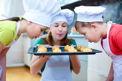 Mother with children making bread royalty free stock photo