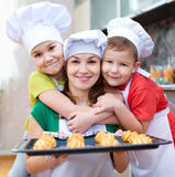 Mother with children making bread stock image