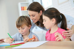 Mother with children making drawings Royalty Free Stock Photos
