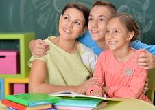 Mother with children. Doing homework together at their room stock photography