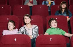 Mother and children in the movie Royalty Free Stock Photo