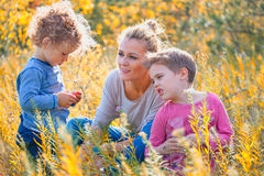 Mother with children outdoor Royalty Free Stock Photos