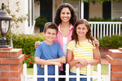 Mother and children outside home Stock Images
