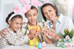 Mother with children painting eggs Royalty Free Stock Images