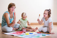 Mother and children painting with paint Royalty Free Stock Photos