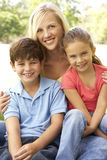 Mother With Children In Park Stock Photo