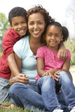 Mother With Children In Park. Smiling royalty free stock photos