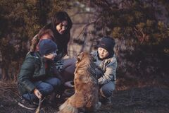 Mother and children with pet dog Stock Photography