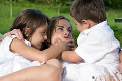 Mother and children playing. A mother playing with her children Royalty Free Stock Photography