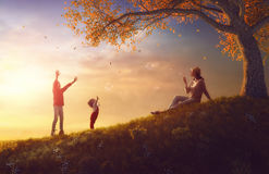Mother and children playing on autumn walk Royalty Free Stock Photos