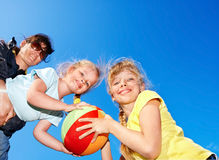 Mother and children playing with ball. Royalty Free Stock Photo