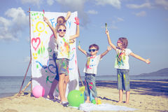 Mother and children playing on the beach at the day time. Stock Photography
