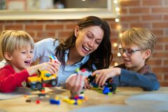 Mother and children playing with blocks. At home Royalty Free Stock Image