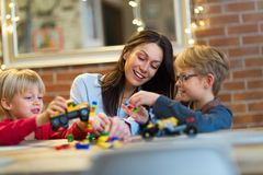 Mother and children playing with blocks. At home Royalty Free Stock Images
