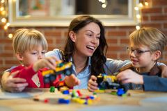 Mother and children playing with blocks royalty free stock photography