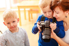 Mother and children playing with camera taking photo Stock Image