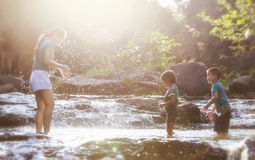Mother and children playing Stock Photo