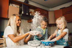 Mother and children playing Royalty Free Stock Images