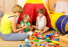 Mother and children playing Royalty Free Stock Photography