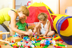 Mother and children playing Stock Image