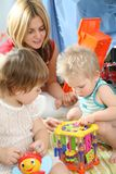 Mother and children in playroom Royalty Free Stock Images