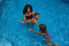 Mother and children in the pool Stock Images
