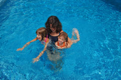 Mother and children in the pool Stock Image