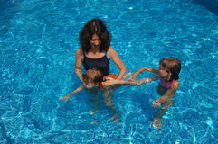 Mother and children in the pool Stock Photography