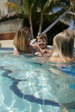 Mother and children in pool. Adult female with two children, boy and girl, in a swimming pool, caucasian/white Stock Photos