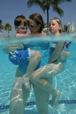 Mother and children in pool Royalty Free Stock Image