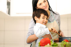 Mother And Children Prepare A meal Royalty Free Stock Photo