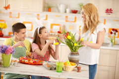 Mother with children preparing Easter celebration Royalty Free Stock Image
