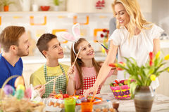 Mother and children preparing Easter eggs Royalty Free Stock Photography