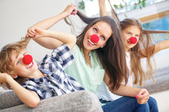 Mother and children with red noses having fun Royalty Free Stock Photography
