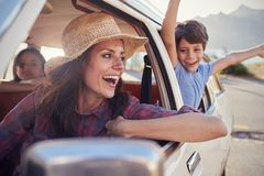 Mother And Children Relaxing In Car During Road Trip Stock Images