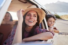 Mother And Children Relaxing In Car During Road Trip Stock Photos