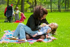 Mother with children resting Stock Images