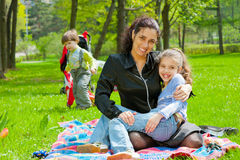 Mother with children resting Royalty Free Stock Images