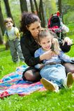 Mother with children resting Royalty Free Stock Image