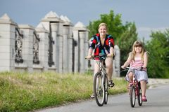 Mother and children riding a bicycle Royalty Free Stock Image