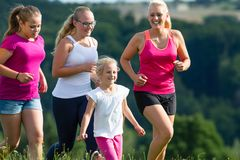 Mother and Children running for better fitness in summer. Mother and Children running for better fitness jogging in summer Royalty Free Stock Photography