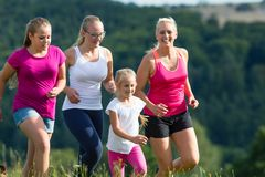 Mother and Children running for better fitness in summer. Mother and Children running for better fitness jogging in summer Royalty Free Stock Image