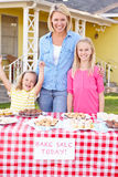Mother And Children Running Charity Bake Sale Stock Image