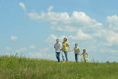 Mother and children running Royalty Free Stock Photography