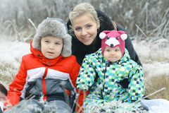 Mother with  children's winter outdoors Stock Photo