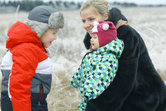 Mother with  children's winter outdoors Royalty Free Stock Photo