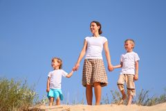 Mother and children on sand Royalty Free Stock Photo