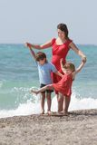 Mother and children on sea background Stock Photo